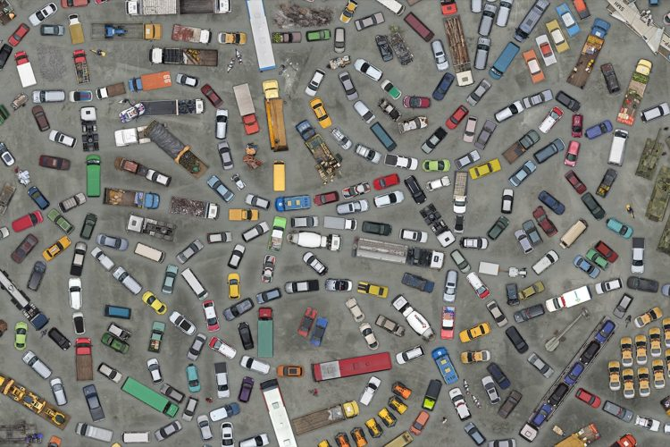hundreds of cars, trucks, buses and other vehicles from above