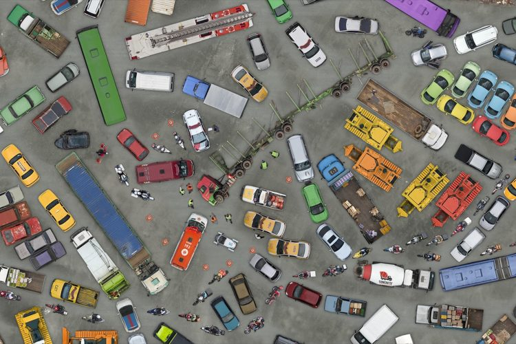 dozes of cars, trucks, buses and other vehicles from above